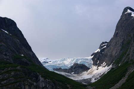 Glacier dropping into ocean, Sawyer Glacier, Endicott Arm Fjord, Alaska