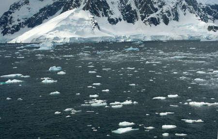 Icebergs, brash ice, in open sea, Lemaire Channel, Antarctica