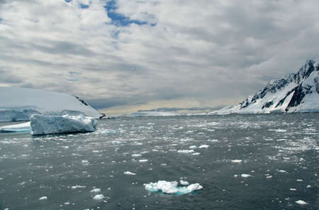 Icebergs, brash ice, in open sea, Lemaire Channel, Antarctica