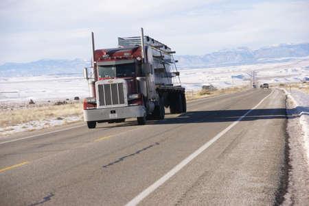 winter road: Red semi truck on winter road,   Utah