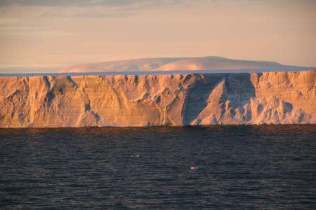 tabular: Sunset with tabular iceberg,  Bransfield Strait,  Antarctica  Stock Photo