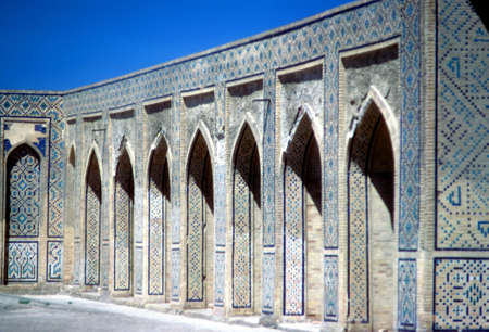Mosaic tiled arches in mosque courtyard,  Samarkand former USSR, now Uzbekistan