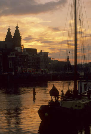 Sunset, sail boat on canal,Amsterdam,Netherlands