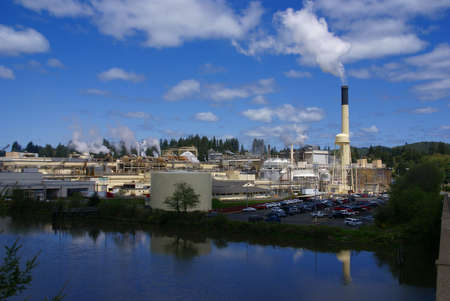 Pulp and paper mill along river,  Toledo,  Oregon Coast 스톡 콘텐츠