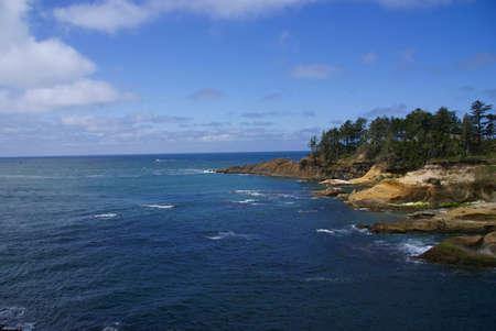 Rocky coast and beach with ocean surf,    Oregon Coast