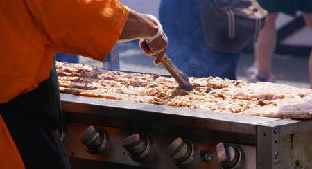 Cooking spicy kebabs at street fair,    Pacific Northwest