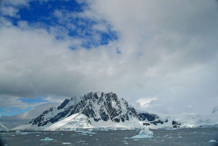 Iceberg, brash ice, mountain glacier,  Lemaire Channel, Antarctica
