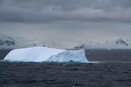 Iceberg glowing in an overcast dawn,  South Shetland Islands, Antarctica