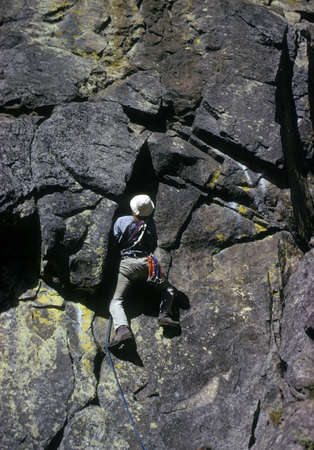 Rock climber on overhanging face,  Cascades Pacific Northwest  photo