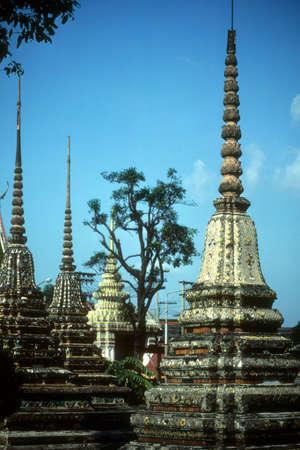 Elaborate decorations on Buddhist temple.   Bangkok, Thailand, Asia