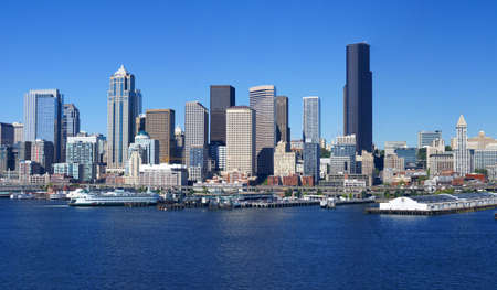 northwest: Panorama - Seattle waterfront skyline,with ferry and dockyard cranes,  Puget Sound,  Pacific Northwest