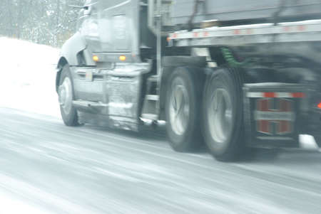 Traffic speeds along icy and snowy roads in western Colorado  photo