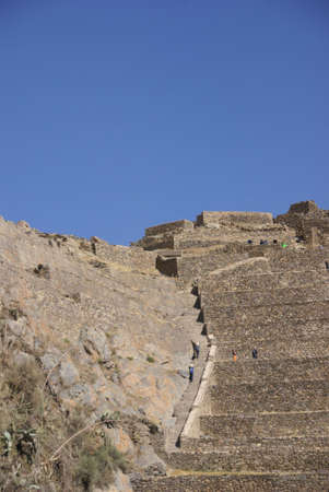 close fitting: Agricultural terraces below Inca city ruins,  Ollantaytambo,  Peru, South America Stock Photo