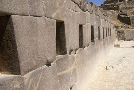 close fitting: Trapezoidal windows in massive Inca stone walls,   Ollantaytambo,  Peru, South America