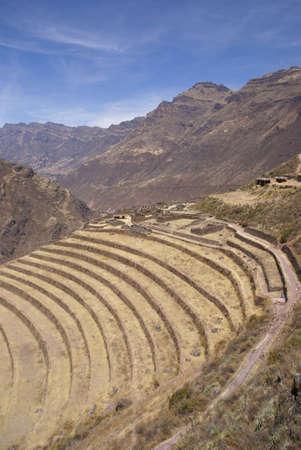 Terraced Inca fields and ruins of village,   Cusco, Peru, South America