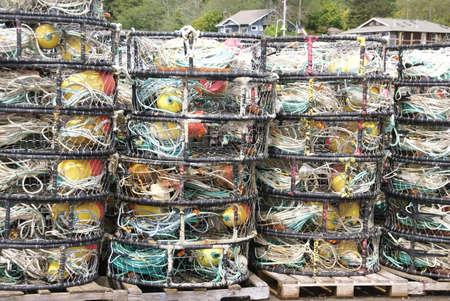 crab pots: Crab traps, pots and floats, stacked on wharf,  Newport, Oregon Coast