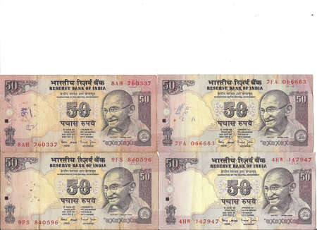 rupee: International currency -Indian rupee notes with portraits of Gandhi