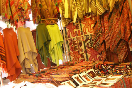 pisac: Colorful handmade blankets & tablecloths, Pisac market,  Cusco, Peru, South America