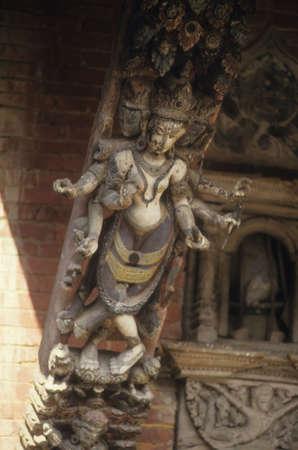 strut: Six armed goddess carved on temple strut,  Kathmandu Nepal, Asia