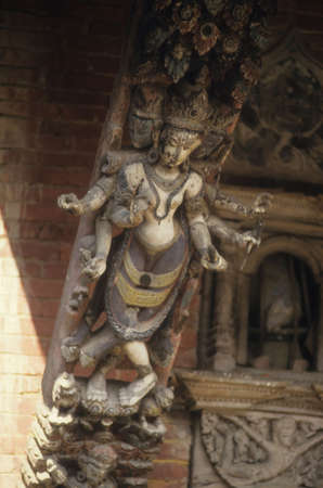 Six armed goddess carved on temple strut,  Kathmandu Nepal, Asia