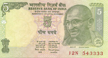 rupee: International currency - Indian 10 rupee note with portrait of Gandhi