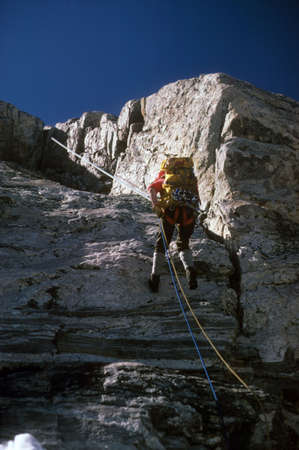 Climber rappelling from summit of Mt Moran,   Grand Tetons National Park,  Wyoming