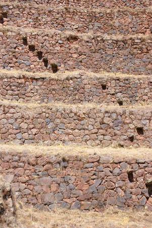Stone stairsteps, Inca stone walls and terraced fields on steep hillside, Pisac market,  Cusco, Peru, South America photo
