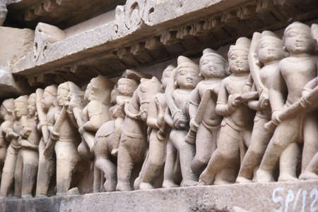 Soldiers and horsemen of the king, carvings on  Lakshmana Temple at  Khajuraho in  India, Asia Stock Photo - 6072305