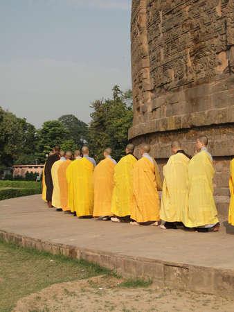 sarnath: SARNATH INDIA - 6 NOV 2009 - Japanese monks and nuns perform Buddhist rituals at Dharmeka Stupa at Sarnath,  India, on 6 Nov 2009.