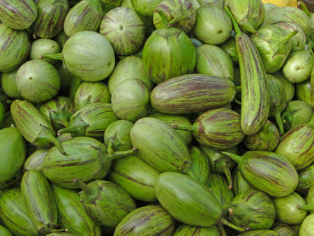 Small, green eggplants at weekly market,   Orissa,  India Stock Photo - 6374900