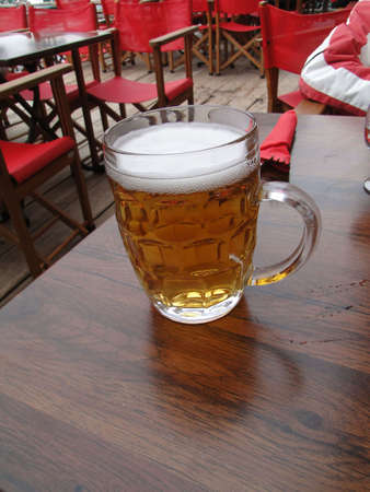 Glass of beer on restaurant table in ski resort at   Chatel,  France            photo