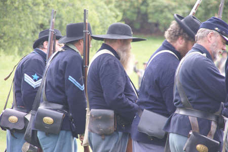 PORT GAMBLE, WA - JUN 20  -   Union infantry skirmishers hold their position during a mock Civil War battle  on Jun 20, 2009 in Port Gamble WA Stock Photo - 6890465