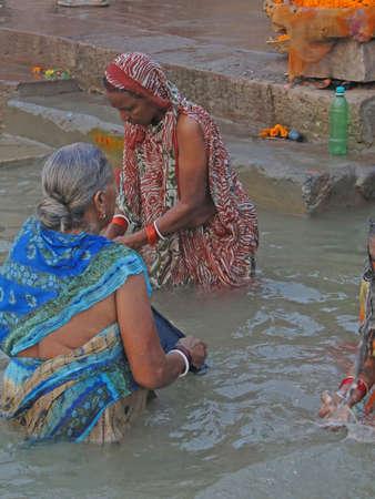 puja: VARANASI, INDIA - NOV 6 -  Hindus perform ritual puja at dawn in the Ganges River  on Nov 6, 2009,  in Varanasi, India.
