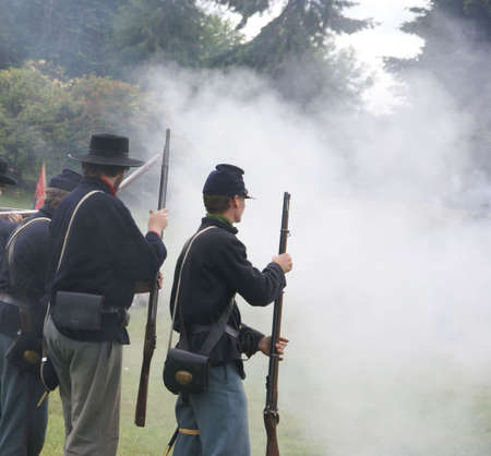 reenactor: PORT GAMBLE, WA - JUN 20  -   Union infantry skirmishers hold their position during a mock Civil War battle  on Jun 20, 2009 in Port Gamble WA Editorial