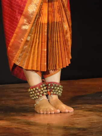 Detail of  Indian dancer performing classical dance   in Khajuraho, India.