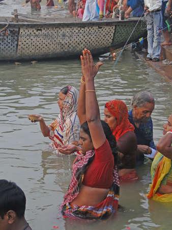 VARANASI, INDIA - NOV 6 -  Hindus perform ritual puja at dawn in the Ganges River  on Nov 6, 2009,  in Varanasi, India.