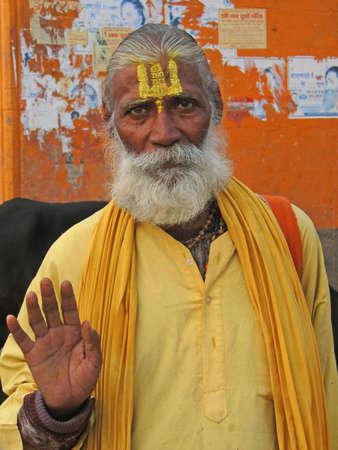 VARANASI, INDIA - NOV 6 -  Hindu Sadhu gives blessings on the bathing ghats on Nov 6, 2009,  in Varanasi, India.