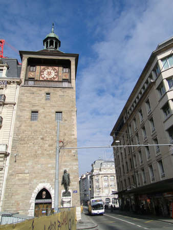 Clocktower on Rhone River in    in Geneva, Switzerland.                   Stock Photo