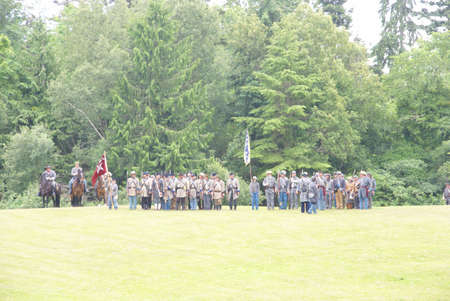 PORT GAMBLE, WA - JUN 20  -   Confederate infantry line holds its position during a mock Civil War battle  on Jun 20, 2009 in Port Gamble WA Editorial