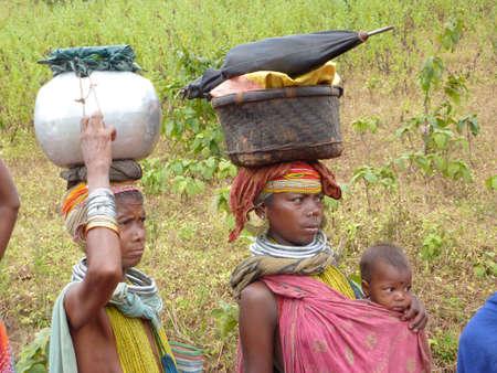 ORISSA,  INDIA - Nov 12 - Bonda tribal women pose for portraits on their way to the  weekly market on Nov 12, 2009 in Ankadeli, Orissa in India   Stock Photo - 6897669