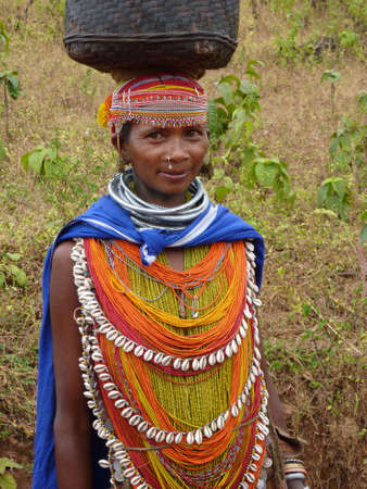 ORISSA,  INDIA - Nov 12 - Bonda tribal woman poses for portrait on her way to the  weekly market on Nov 12, 2009 in Ankadeli, Orissa in India