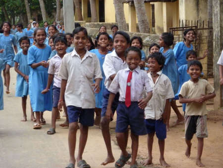 PURI, INDIA - NOV 17 - Curious local school children greet visiting foreign guests  on Nov 17, 2009 in Puri, India   에디토리얼