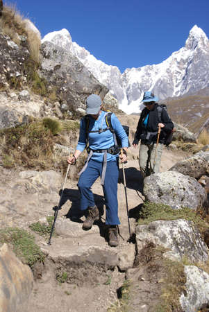 steep: Women hikers descending steep trail in the  Cordillera Huayhuash, Andes,  Peru, South America Stock Photo