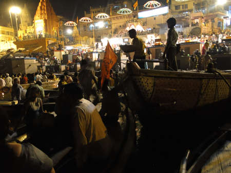VARANASI, INDIA - NOV 5 -  Boatloads of tourists and Hindu pilgrims attend aarti evening services   at Dashashvemedha Ghat on Nov 5, 2009, in Varanasi, India.