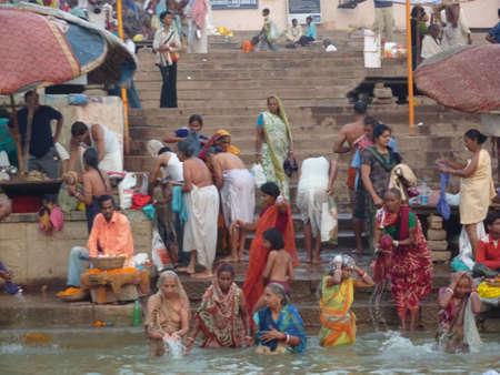 VARANASI, INDIA - NOV 6 -  Hindus perform ritual puja at dawn in the Ganges River  on Nov 6, 2009,  in Varanasi, India. Editorial
