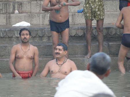puja: VARANASI, INDIA - NOV 6 -  Hindus perform ritual puja at dawn in the Ganges River  on Nov 6, 2009,  in Varanasi, India.                 Editorial