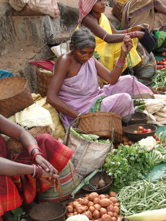 ORISSA,  INDIA - Nov 12 -Tribal woman sells vegetables  in weekly market  on Nov 12, 2009 in Ankadeli, Orissa in India                       Stock Photo - 7007352