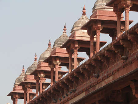 Detail, Islamic  decorations on red sandstone Fatepuhr Sikri, Agra,India                          photo