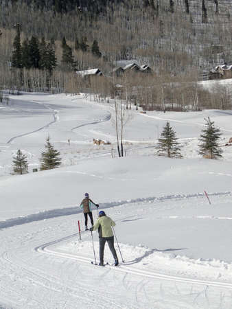 across: Cross country skiers skate across snowy meadows    Colorado