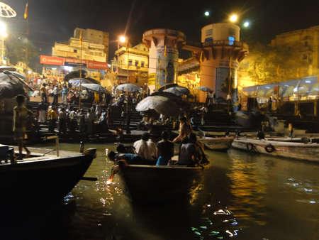 VARANASI, INDIA - NOV 5 -  Boatloads of tourists and Hindu pilgrims attend aarti evening services   at Dashashvemedha Ghat on Nov 5, 2009, in Varanasi, India.             Stock Photo - 7137895